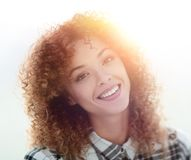 Portrait of a beautiful young woman with curly hair. Beautiful young woman with curly hair. Photo with blank space for text Stock Images