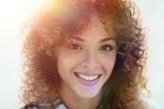 Portrait of a beautiful young woman with curly hair. Beautiful young woman with curly hair. Photo with blank space for text Stock Image