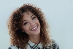 Portrait of a beautiful young woman with curly hair. Beautiful young woman with curly hair. Photo with blank space for text Royalty Free Stock Images