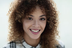 Portrait of a beautiful young woman with curly hair. Royalty Free Stock Images