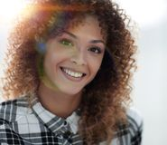 Portrait of a beautiful young woman with curly hair. Beautiful young woman with curly hair. Photo with blank space for text Stock Photography