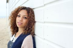 Beautiful young woman with curly hair posing outdoors Stock Images