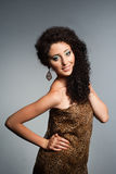 Beautiful young woman with curly hair Royalty Free Stock Photo