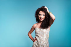 Beautiful young woman with curly hair Stock Photos