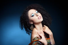 Beautiful young woman with curly hair Stock Photography