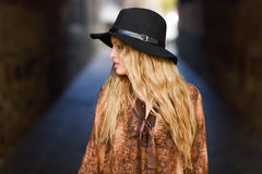 Beautiful young woman with curly hair wearing hat Royalty Free Stock Photo