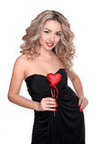 Beautiful young woman with curly long hair holding heart Stock Photography