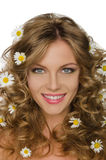 Beautiful young woman with daisies in hair Royalty Free Stock Photos
