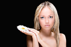 Beautiful young woman with daisy flower Royalty Free Stock Image