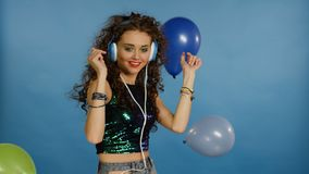Beautiful young woman dance with colorful balloons stock video
