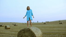 Beautiful young woman dancing in a haystack. stock video footage