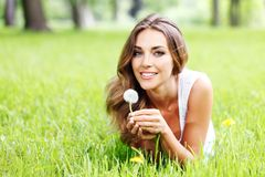 Beautiful young woman with dandelion Stock Image