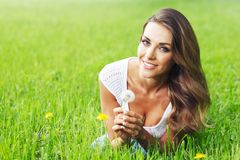 Beautiful young woman with dandelion Royalty Free Stock Photography