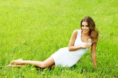 Beautiful young woman with dandelion Stock Images