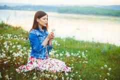 Woman among dandelions stock photos
