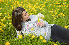 Beautiful young woman with dandelions Royalty Free Stock Image