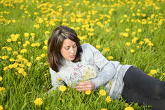 Beautiful young woman with dandelions Stock Photos