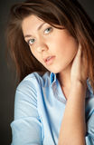 Beautiful young woman on dark background Stock Photography