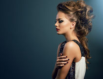 Beautiful young woman on dark background Stock Image