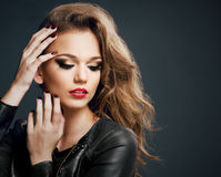 Beautiful young woman on dark background Stock Images