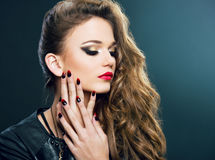 Beautiful young woman on dark background Royalty Free Stock Photos