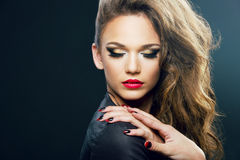 Beautiful young woman on dark background Royalty Free Stock Images