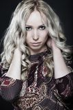 Beautiful young woman on dark background Royalty Free Stock Photography