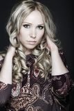 Beautiful young woman on dark background Royalty Free Stock Photo
