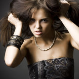 Beautiful young woman with dark hair Stock Photo
