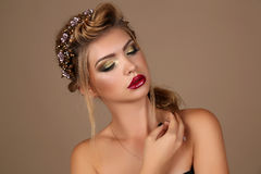 Beautiful young woman with dark hair with bright makeup Royalty Free Stock Photography