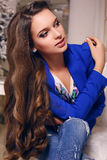 Beautiful young woman with dark hair in elegant jacket and jeans Stock Photography