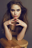 Beautiful young woman with dark long hair and bright makeup Stock Images