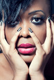 Beautiful young woman with dark makeup Stock Photography