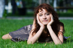 Beautiful young woman daydreaming. Royalty Free Stock Images