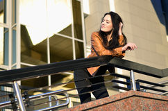 Beautiful young woman daydreaming. Beautiful brunette young woman daydreaming Royalty Free Stock Image