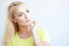 Beautiful young woman daydreaming Stock Images