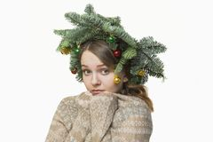 Portrait of beautiful young woman with Christmas wreath on a whi Royalty Free Stock Images