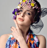 Beautiful young woman with delicate flowers in their hair Stock Image