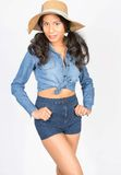 Beautiful Young Woman in Denim Attire with Hat Royalty Free Stock Images
