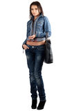 Beautiful young woman in a denim suit Stock Photo