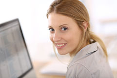 Beautiful young woman on desktop computer Royalty Free Stock Image