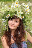 Beautiful young woman in diadem of wildflowers Stock Photos