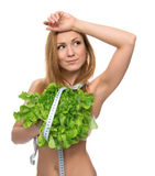 Beautiful Young Woman on diet with healthy food salad and tape m Stock Photos