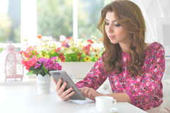 Beautiful young woman with digital tablet Royalty Free Stock Photo