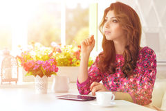 Beautiful young woman with digital tablet Stock Photos