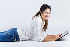 Beautiful young woman with digital tablet Royalty Free Stock Image