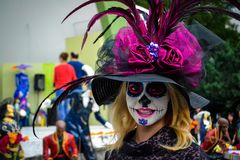 Mexico City, Mexico, ; November 1 2015: Beautiful young woman in disguise at the Day of the Dead celebration in Mexico City royalty free stock photo