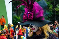 Mexico City, Mexico, ; November 1 2015: Beautiful young woman in disguise at the Day of the Dead celebration in Mexico City royalty free stock images