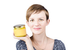 Beautiful young woman displaying jar of ghee Royalty Free Stock Photo