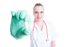 Beautiful young woman doctor with capsule in her hand Stock Photos